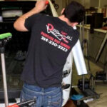 paintless dent repair employee